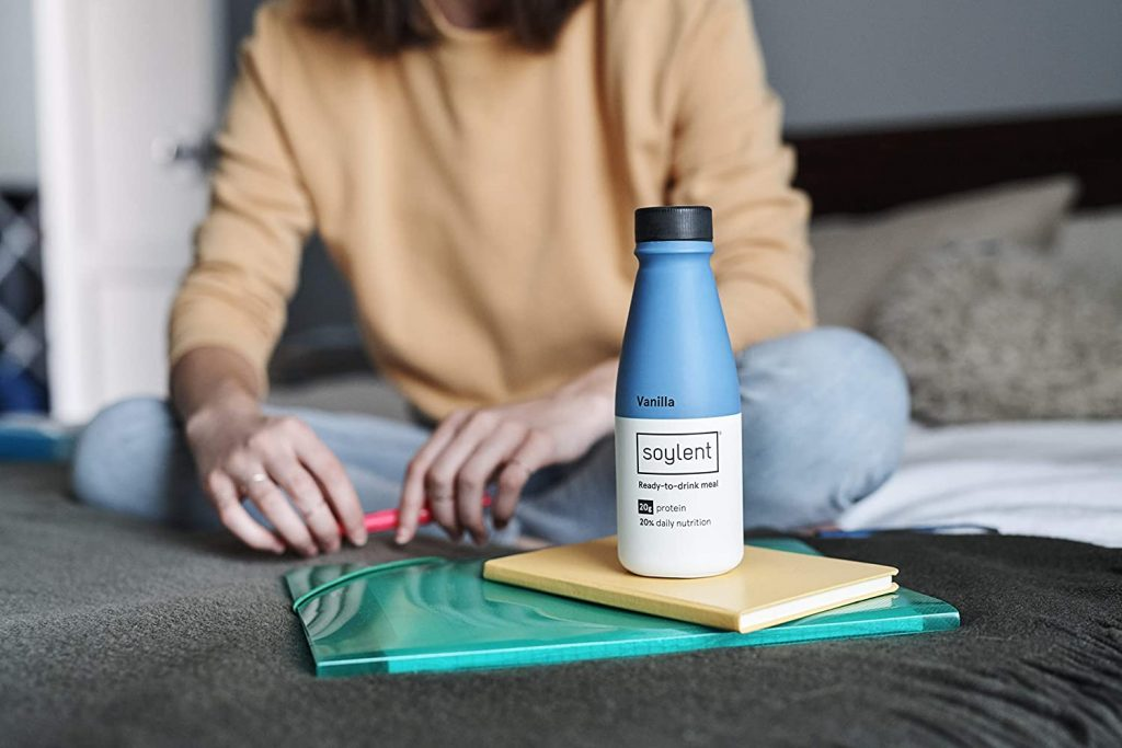 Working woman with Soylent Drink